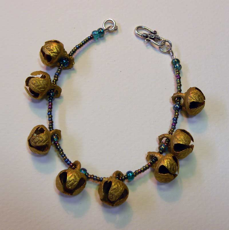 Brass Bells, Glass Beads, Sterling Silver clasp